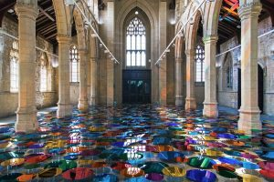 Liz West |700 circular mirrors church