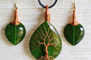Discarded Copper Wire Twisted into Trees to Beautifully Frame Dazzling Stone Pendants